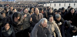 North Koreans cry in front of the Statue of the Sun in Pyongyang in this picture released by the North's official KCNA news agency